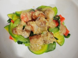 Creamy ginger sauce over pan fried scallops and vegetables